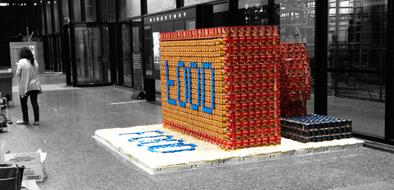 Sculpture of cans with the word food spelt in a different colour