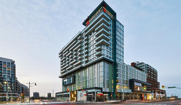 Marriott Hotel in Downtown Markham with ground floor retail, a podium with black framed cut outs and balconies on the upper levels