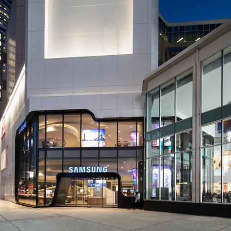exterior of the Samsung store from the sidewalk in front of the Eaton Centre at dusk