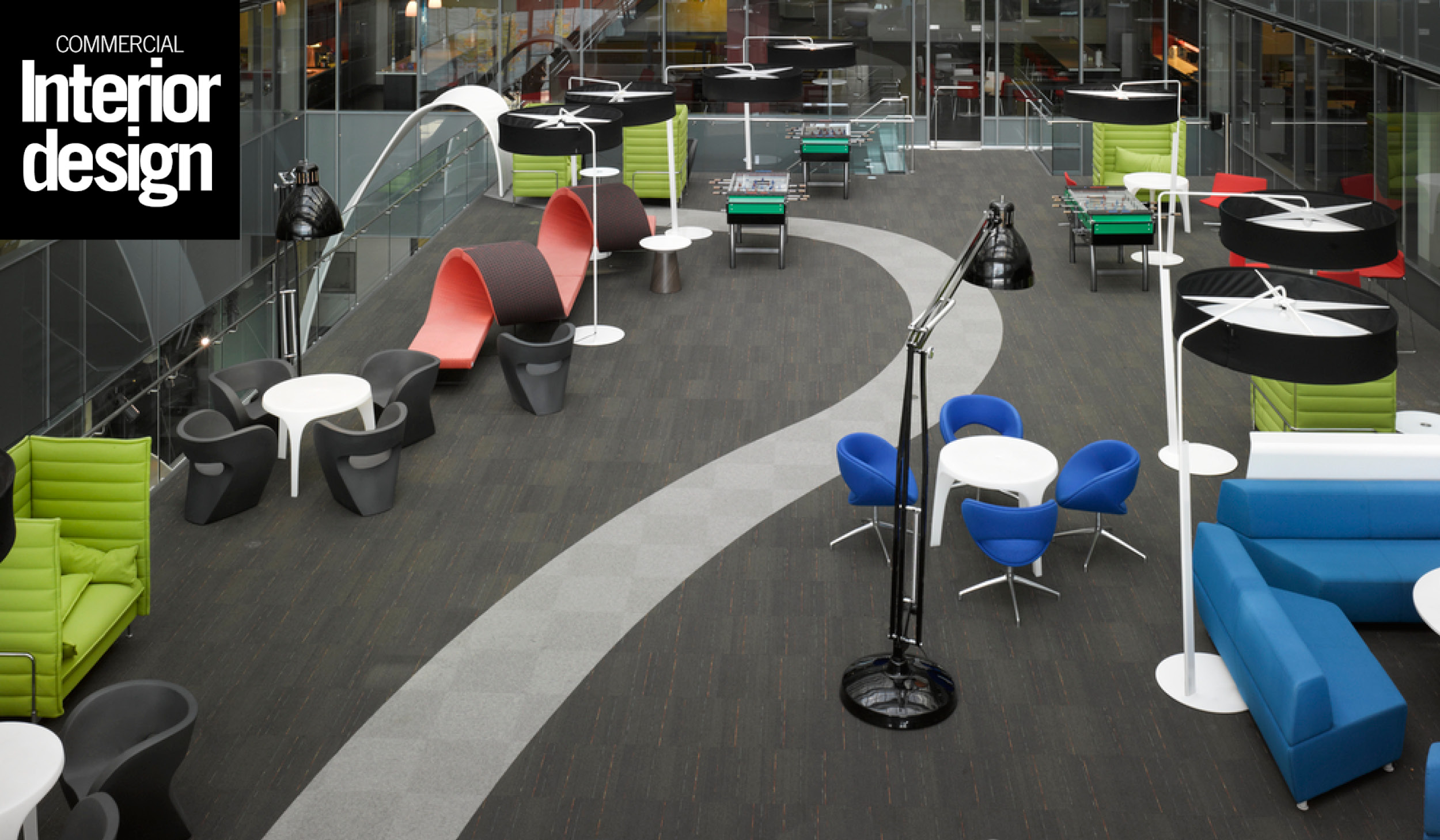 photo of colourful seating furniture in a lounge area at the Corus Entertainment headquarters with the Commercial Interior Design logo in the top left corner