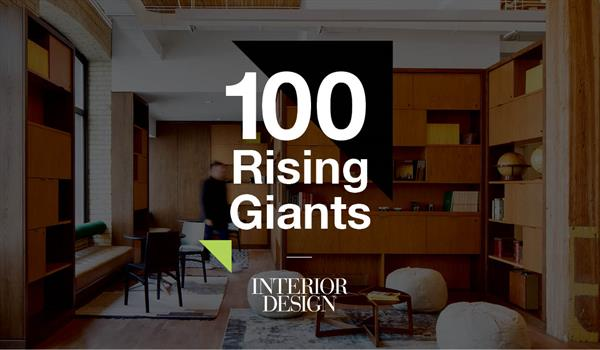 the words 100 Rising Giants above Interior Design magazine's logo and framed by Quadrangle green and black triangles, superimposed over a photo of a lounge space with wooden cabinetry and floor cushions