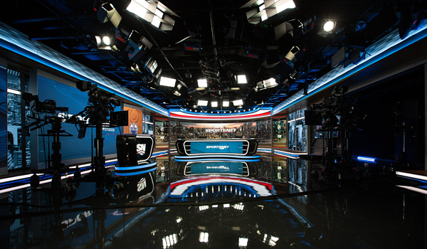 Sportsnet tv broadcast production studio showing the studio set with desks, screens and professional lighting