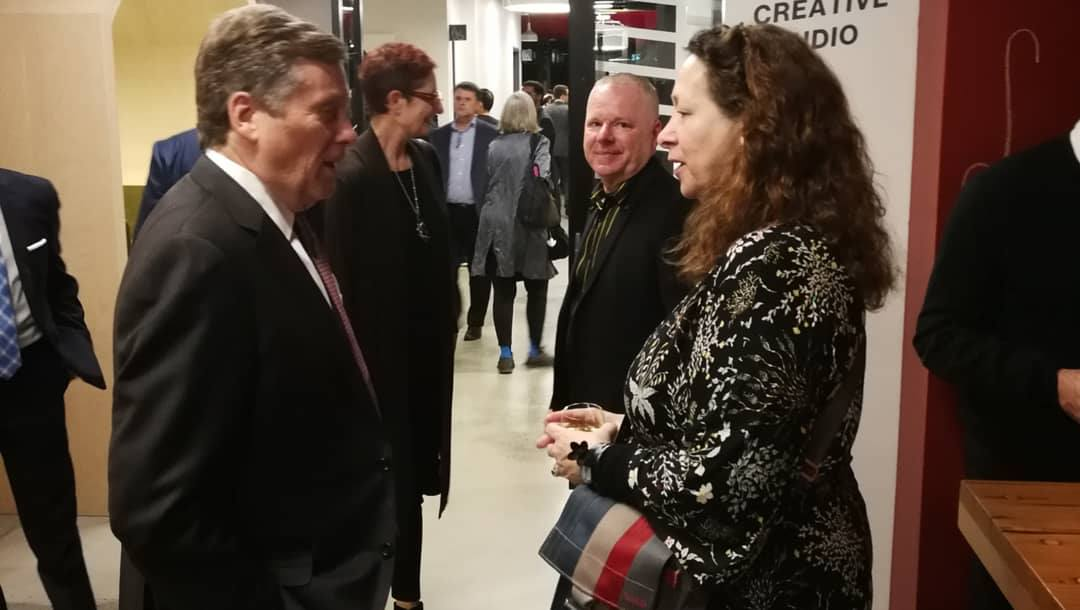 Caroline Robbie speaking to Toronto Mayor John Tory at the Artscape Daniels Launchpad opening party