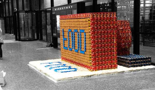 a structure made of canned foods in the shape of a ink-pad stamp