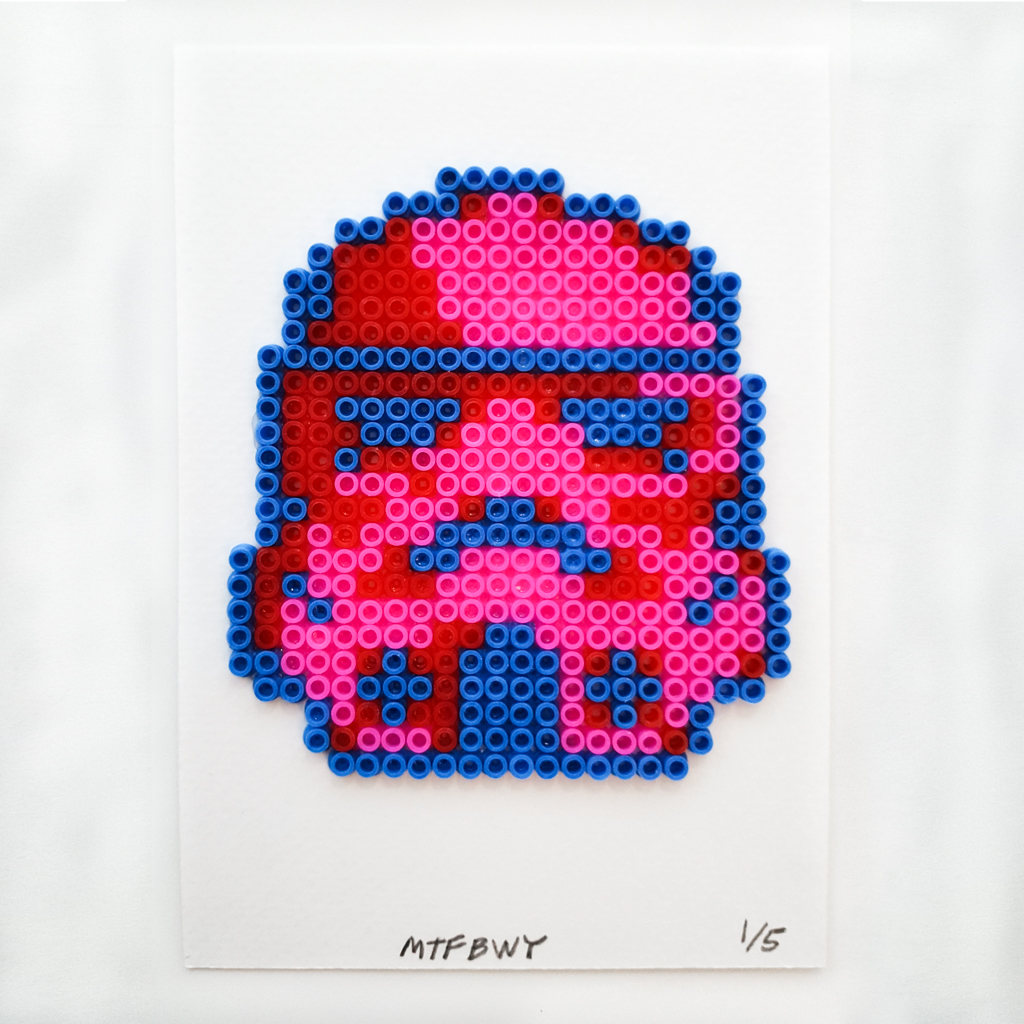 a pink and blue stormtrooper helmet made of rubber beads