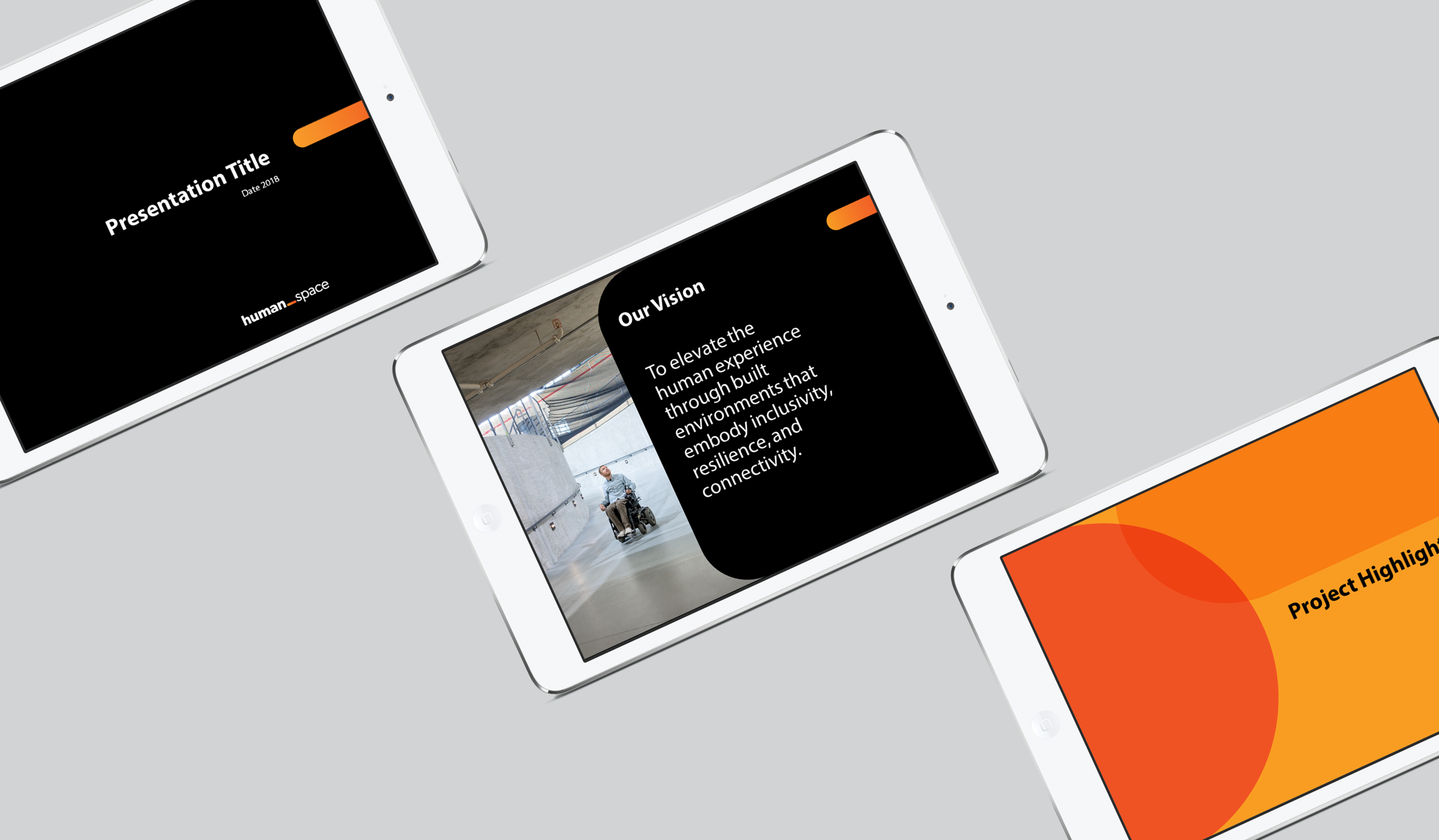 "three tablets showing a Human Space presentation title page, a presentation slide titled ""Our Vision"" on black beside a photo of a man in a mobility device using a ramp, and a presentation slide ""Project Highlights"" on orange background with darker orange"