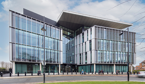 five-storey modern glazed office building with rooftop terrace