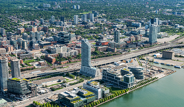 aerial photo showing the high rise condominium Monde in its urban context on the Toronto waterfont