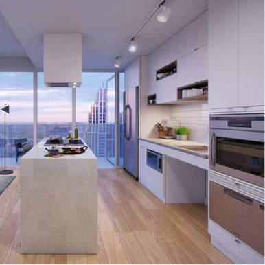 a condominium kitchen with low counters, white marble island and side opening oven