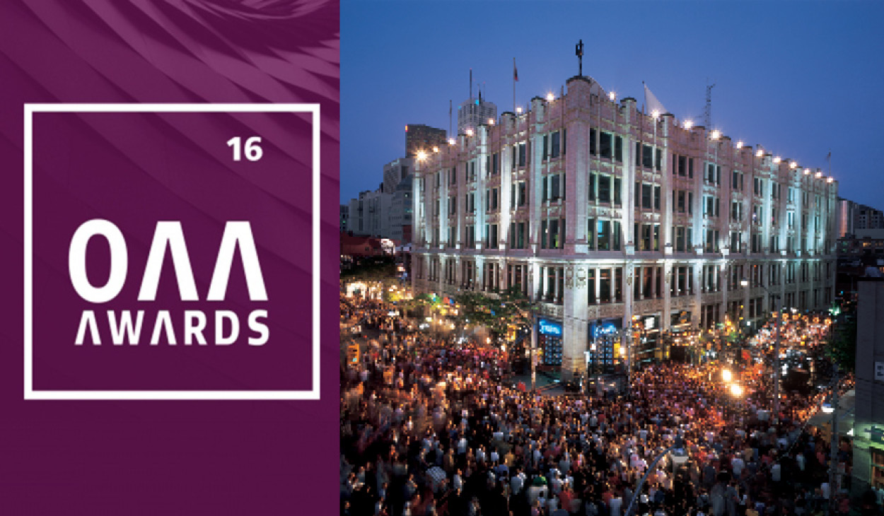 photo of 299 Queen West at dusk surrounded by a large crowd of people for an event, adjacent to the OAA Awards 2016 logo