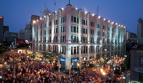 the CHUM building, home of MuchMusic and Speakers Corner, surrounded by crowds of people during an event