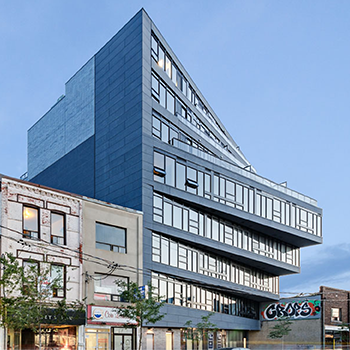photo from the street of Abacus Lofts, showing its dynamic angled facade