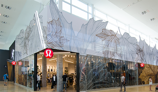 Lululemon storefront in a mall with glazing in the shape of leaves