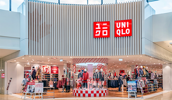 Uniqlo outlet in Toronto's Square One mall, showing a storefront with a subtle maple leaf embedded and predominantly red and white product displays