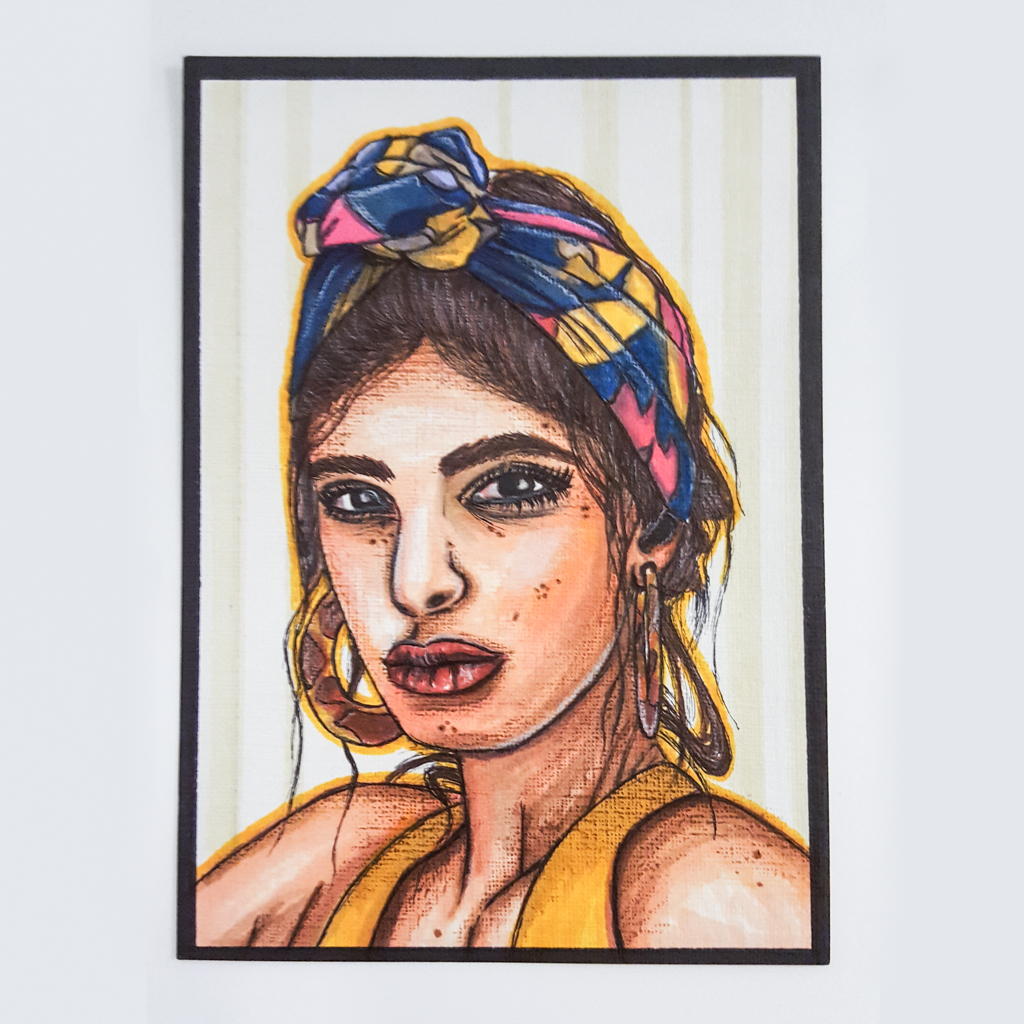 coloured pencil sketch of a young woman wearing a colourful head scarf and large hoop earrings