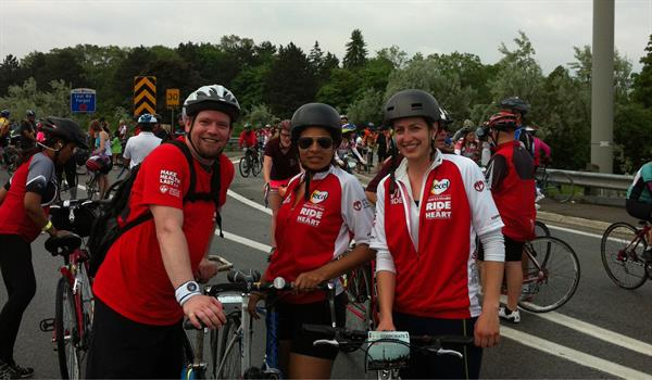 three Ride for Heart cyclists pose during a break in cycling on the Gardiner Expressway