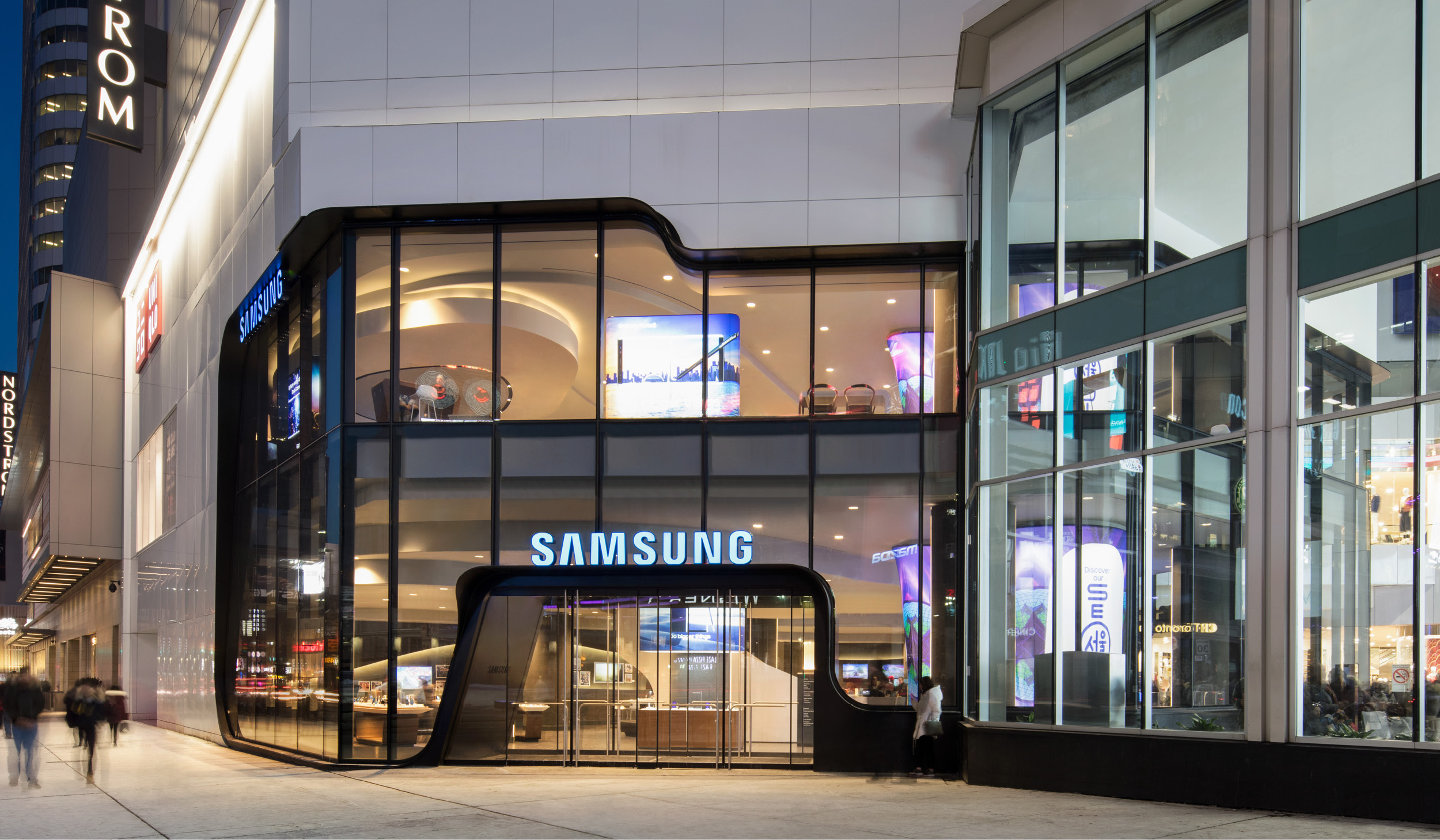 exterior of the Samsung Experience Store at the Eaton Centre, taken from the sidewalk at dusk