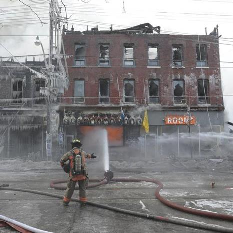 Firemen putting out fire at 619 Queen Street West