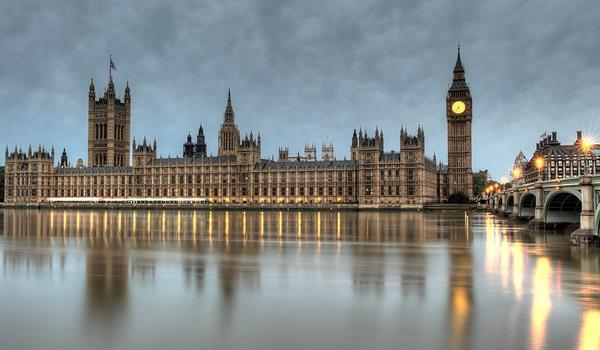 Palace of Westminster and Big Ben in London viewed from the Thames