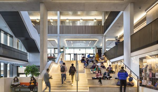 inside UCL Student Centre with ampitheatre seating stairs